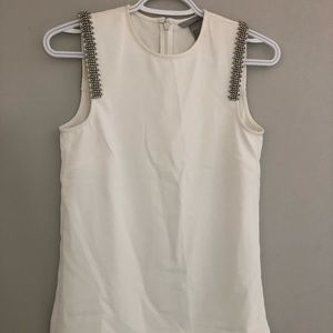 Sleeveless top with embellishments